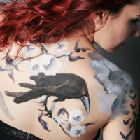 crow on a branch non-nude body painting idea