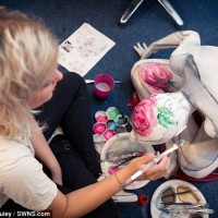 Paint a contortionist? Piece of cake! Body artist creates a clever tea party to celebrate Macmillan charity event