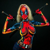 Woman transforms into incredible superheroes by painting costumes onto her body