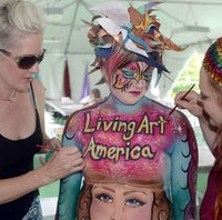 Artists paint model for first body art display at local Virginia festival