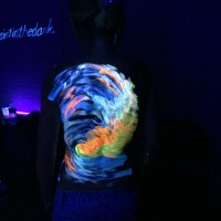 carry the ocean uv body painting - back