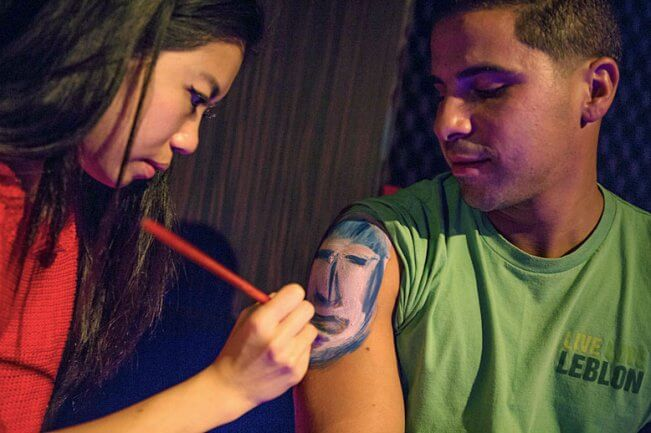 Couple painting each other at PaintDate event
